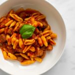 A plate of cavatelli pasta with pork ragu