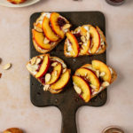Ricotta, Peach Toast with blackberry compote topped with almonds and honey